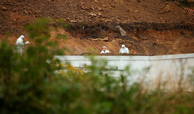 Police officers search a site in Barnsley. Photo: Lynne Cameron/PA Wire