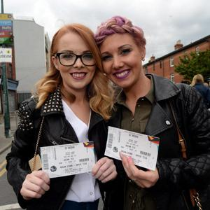 Therese Murray, left, 26, and sister Niamh Donohoe, 31, fro Cabra, on their way to the Ed Sheeran concert in Croke Park, Dublin. Picture: Caroline Quinn