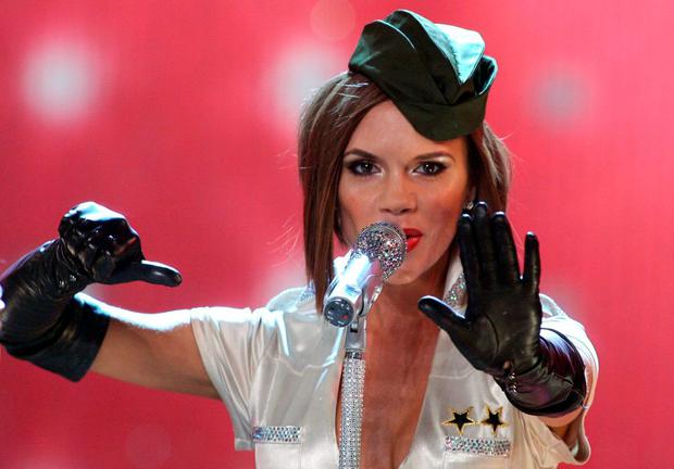 Spice Girls' Victoria Beckham performs during the Victoria's Secret fashion show at the Kodak Theatre in Hollywood, California, 15 November 2007. AFP PHOTO/GABRIEL BOUYS (Photo credit should read GABRIEL BOUYS/AFP/Getty Images)