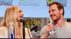 Actors Jennifer Lawrence and Michael Fassbender of 'X-Men: Apocalypse' speak onstage at the 20th Century FOX panel during Comic-Con International 2015 at the San Diego Convention Center on July 11, 2015 in San Diego, California.