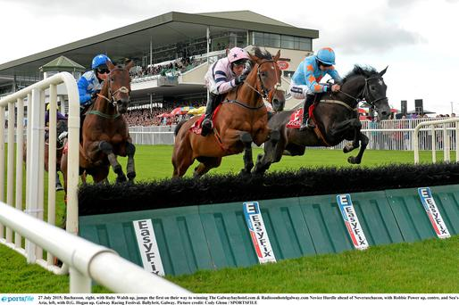 27 July 2015; Bachasson, right, with Ruby Walsh up, jumps the first on their way to winning The Galwaybayhotel.com & Radissonhotelgalway.com Novice Hurdle ahead of Neveruschacon, with Robbie Power up, centre, and Sea's Aria, left, with D.G. Hogan up. Galway Racing Festival. Ballybrit, Galway. Picture credit: Cody Glenn / SPORTSFILE
