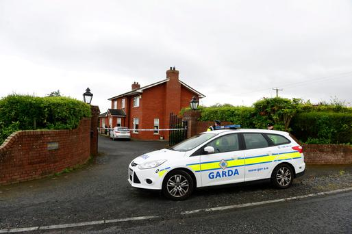 27.7.2015. Pictured is the house where Gardai have discovered the body of a woman with serious head injuries. Picture Ciara Wilkinson.