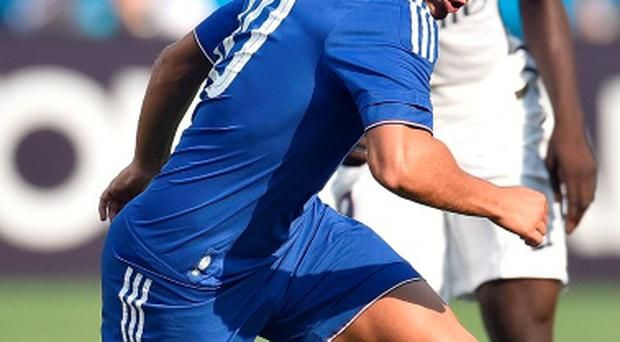 Jose Mourinho believes that Eden Hazard, seen here in action against Paris St-Germain, is as good as Lionel Messi and Cristiano Ronaldo