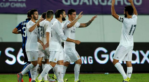 Real Madrid's James Rodriguez (2nd R) celebrates his goal with team mates during their International Champions Cup against Inter Milan at Tianhe Stadium in the southern Chinese city of Guangzhou, China July 27, 2015. REUTERS/Tyrone Siu