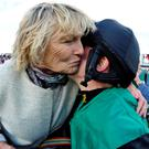 Jessica Harrington congratulates her daughter Kate after her victory on Modem at Galway yesterday.