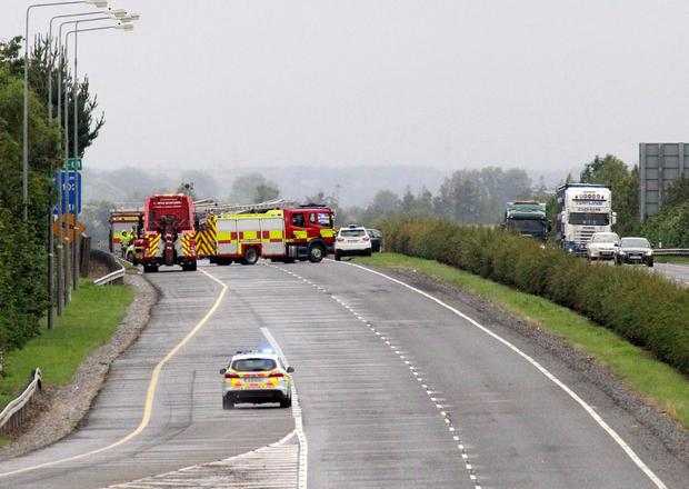 27/7/15 Gardai investigate a fatal car crash near Castlebellingham on the M1 Northbound. Picture:Arthur Carron