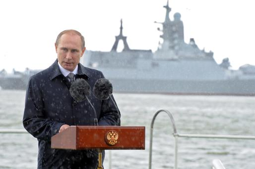 Russian President Vladimir Putin delivers a speech during celebrations for Navy Day as it rains in Baltiysk, Kaliningrad region. Photo: Reuters