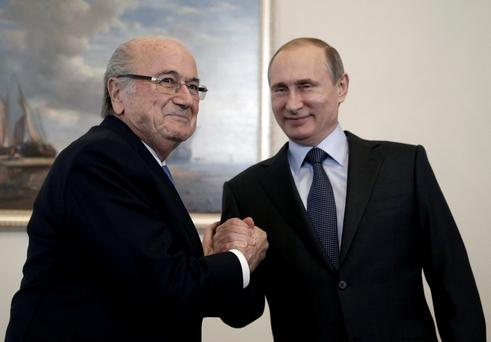 Russian President Vladimir Putin (R) shakes hands with FIFA president Sepp Blatter during a meeting in St. Petersburg, Russia, July 25, 2015
