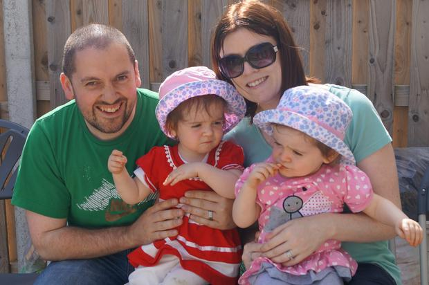 Inventor Paddy Healy (37) with his wife and twin daughters