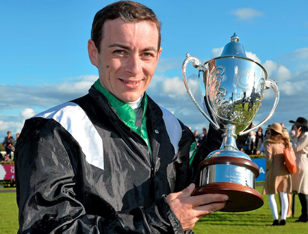 Jockey Wayne Lordan with the trophy after winning the Topaz Mile Handicap on Hint Of A Tint. Galway Racing Festival, Ballybrit, Galway. Picture credit: Cody Glenn / SPORTSFILE