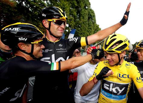 Chris Froome is congratulated after his Tour de France victory by team-mates Nicolas Roche, left, and Geraint Thomas in Paris on Sunday. ERIC GAILLARD/REUTERS
