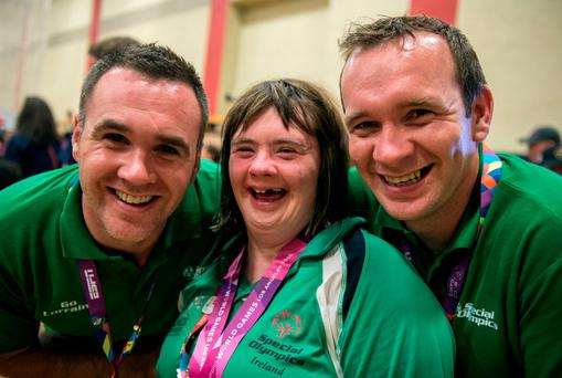 Team Ireland's Lorraine Hession from Turloughmore, Co Galway, with her brothers Paul and Joseph after receiving her 4th place ribbon for the AQ 100M Freestyle F14 swim event