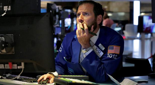 Specialist Mike Pistillo works on the floor of the New York Stock Exchange. Photo: AP