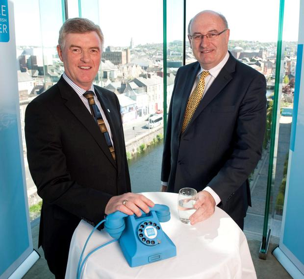 Irish Water boss John Tierney and then-Environment Minister Phil Hogan are all smiles at the announcement of Irish Water's Cork call centre in May 2013