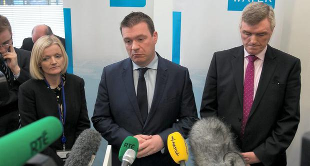 Irish Water commuinications head Elizabeth Arnett, Environment Minister Alan Kelly, and John Tierney address the media