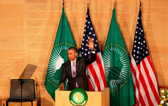 U.S. President Barack Obama salutes delegates after delivering remarks at the African Union in Addis Ababa, Ethiopia July 28, 2015. Obama toured a U.S.-supported food factory in Ethiopia on Tuesday on the last leg of an Africa trip, before winding up his visit at the African Union where he will become the first U.S. president to address the 54-nation body. REUTERS/Tiksa Negeri