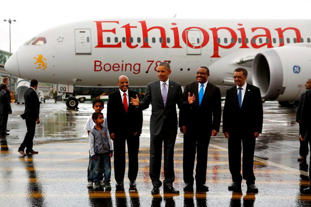 U.S. President Barack Obama (C), flanked by Ethiopian Airlines CEO Tewolde Gebremariam (L) and Ethiopia's Prime Minister Hailemariam Desalegn (2nd R), talks to reporters after viewing a Boeing 787 Dreamliner from Ethiopian Airlines at Bole International Airport before departing Addis Ababa, Ethiopia July 28, 2015. REUTERS/Jonathan Ernst
