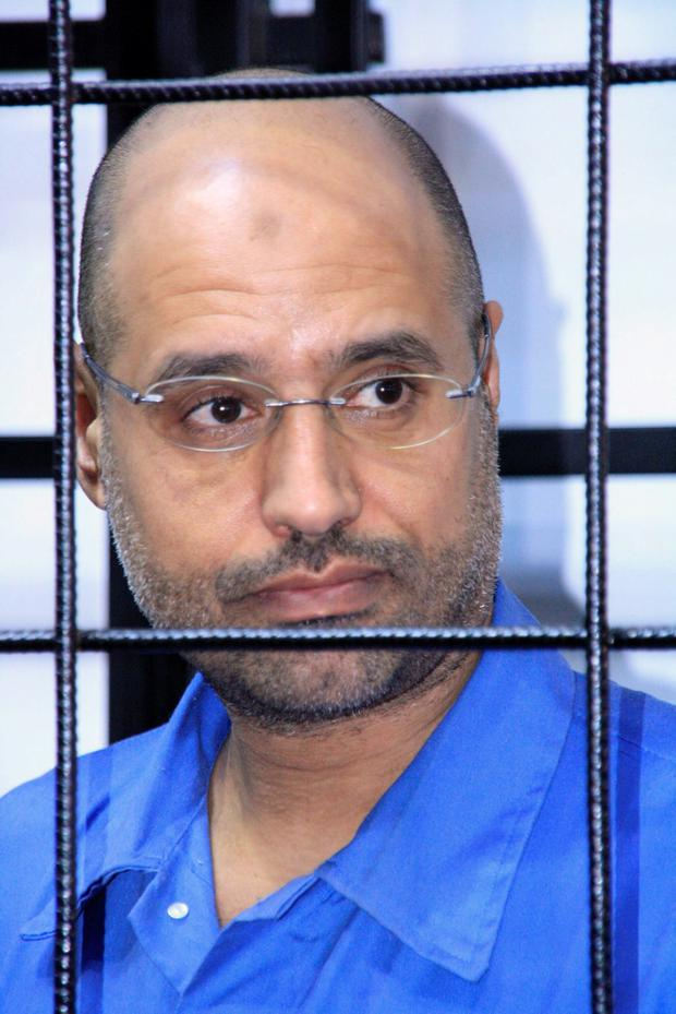 Saif al-Islam Gaddafi, son of late Libyan leader Muammar Gaddafi, attends a hearing behind bars in a courtroom in Zintan, Libya. Photo: Reuters