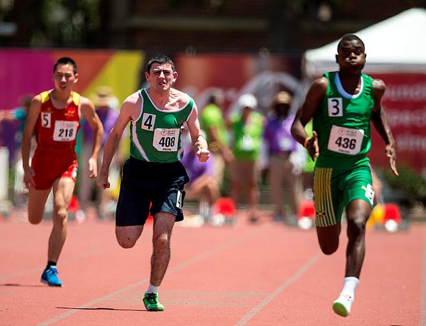 28 July 2015; Team Ireland's James Meenan, 408, a member of St Therese's Special Olympics Club, from Dundalk Co Louth, races alongside fellow athletes, Jie Zhang, 218, SO China, and Keith Ricketts, 436, on his way to qualifying for the finals of the 100m at the Katherine B. Loker Stadium. Special Olympics World Summer Games, Los Angeles, California, United States. Picture credit: Ray McManus / SPORTSFILE