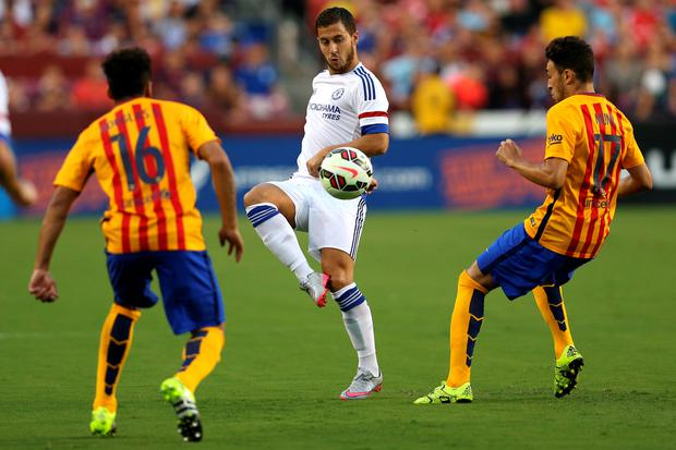 Eden Hazard #10 of Chelsea passes between two Barcelona defenders in the first half during the International Champions Cup North America at FedExField on July 28, 2015 in Landover, Maryland. (Photo by Patrick Smith/Getty Images)