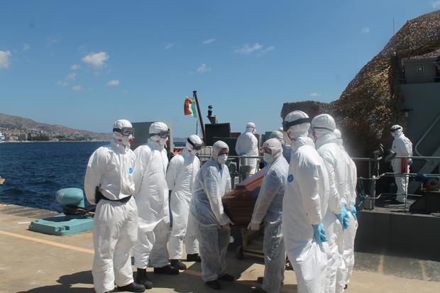 There were the remains of 14 bodies removed from a wooden barge Credit: Irish Defence Forces