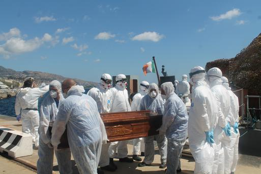 Crew Members of the LE Niamh carry remains from the vessel Credit: Irish Defence Forces