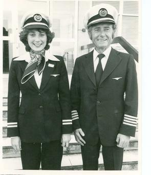 Photo Caption 1: Captain Grainne Cronin, pictured with her father, retired Aer Lingus Captain Felim Cronin. This was Grainne Cronin's first day in the job as the first female Aer Lingus pilot. Felim Cronin joined Aer Lingus as a pilot in 1961, he was made Captain in 1969, and flew eight different types of aircraft with the airline until 1986.