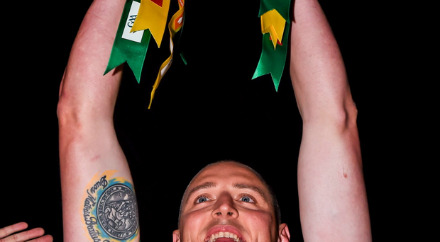 Kerry captain Kieran Donaghy lifts the cup