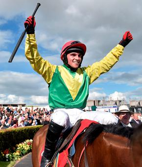 Jonathan Burke celebrates after winning the Galway Plate on Shanahan's Turn
