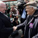 President Michael D Higgins shakes the hand of 94-year-old Bill Martin from Athy at the Galway Races yesterday