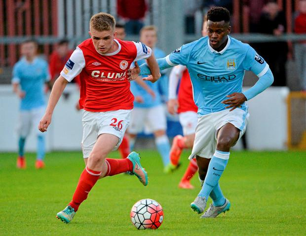 Jack Bayly, St Patrick's Athletic, in action against Ashley Smith-Brown, Manchester City Elite Development Squad.
