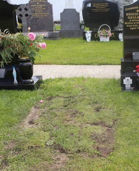 The closed grave where garda exhumed a body at Annagery, Co. Donegal. (North West Newspix)