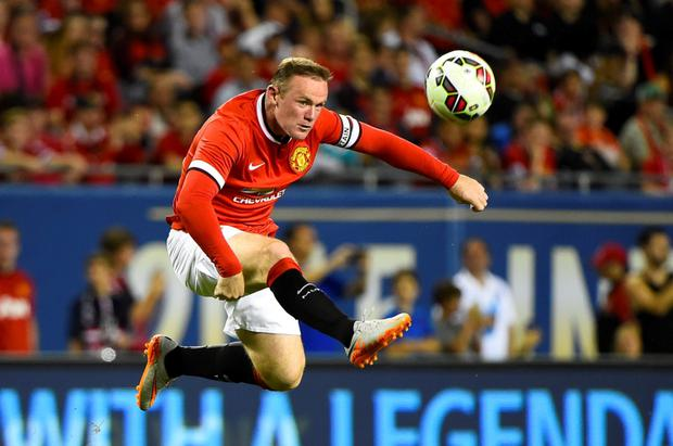 Manchester United forward Wayne Rooney in action against PSG