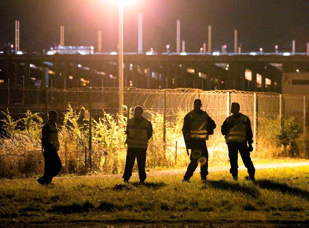 French National Gendarmerie on guard around the perimeter security fencing of the Eurotunnel site at Coquelles in Calais, France Credit: Yui Mok/PA Wire