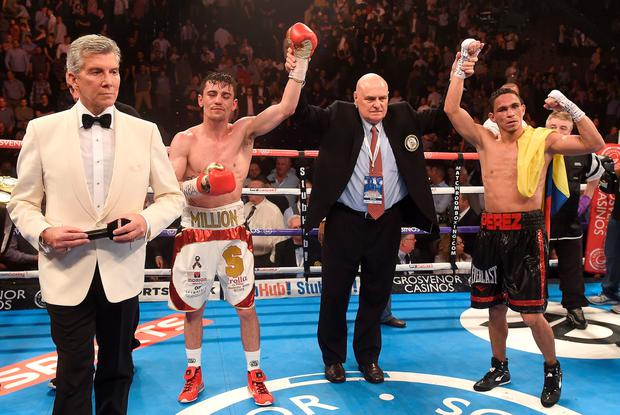 Anthony Crolla (2nd left) after his WBA World Lightweight Championship fight against Darleys Perez was called a draw with announcer Michael Buffer (left), at Manchester Arena, Manchester