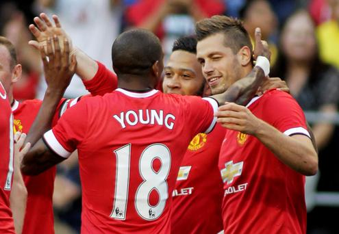 Manchester United's Morgan Schneiderlin (R) celebrates scoring a goal with Ashley Young (L) and Memphis Depay (C) Action Images via Reuters / Anthony Bolante Livepic EDITORIAL USE ONLY.