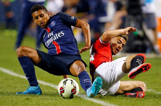 Paris St Germain's Marquinhos (L) in action with Manchester United's Andreas Pereira Action Images via Reuters / Jeff Haynes Livepic