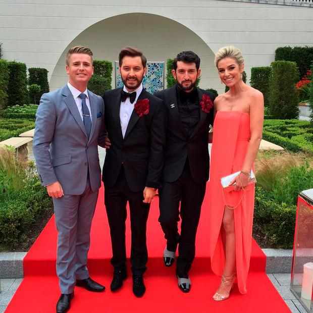 Brian Dowling and husband Arthur Gourounlia pose with Pippa and Brian Ormond Pic: Instagram