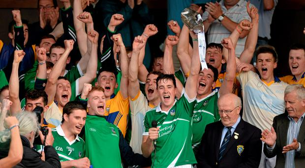 Limerick captain Diarmaid Byrnes lifts trophy sca after victory over Clare