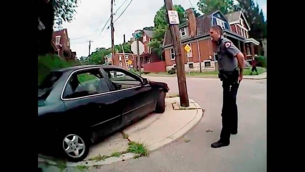University of Cincinnati police officer Ray Tensing stands near a car after driver Samuel Dubose was allegedly pulled over and shot during a traffic stop in Cincinnati, Ohio July 19, 2015, in a still image from body camera video released by the Hamilton County Prosecutor's Office on July 29, 2015. REUTERS/Hamilton County Prosecutor's Office/Handout via Reuters