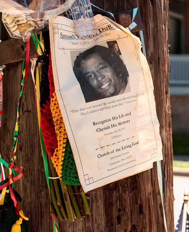 An impromptu memorial for Samuel Dubose is posted near the crime scene in Cincinnati, Ohio July 30, 2015. Former Cincinnati campus police officer Ray Tensing was indicted on Wednesday on murder and voluntary manslaughter charges in the July 19 death of Dubose, who was shot in the head during a traffic stop. REUTERS/William Philpott