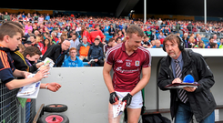 Johnny Glynn signs an autograph prior to giving a television interview after last weekend's victory over Cork