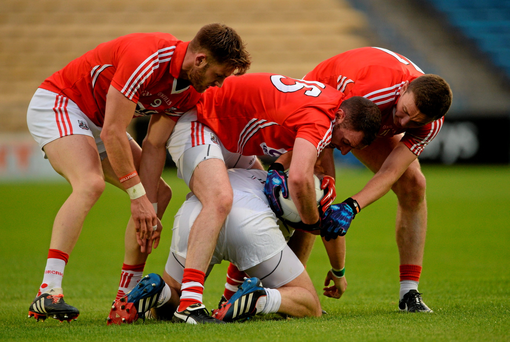 Kildare's Tommy Moolick is surrounded by Cork's Eoin Cadogan, Donncha O'Connor and Mark Collins.