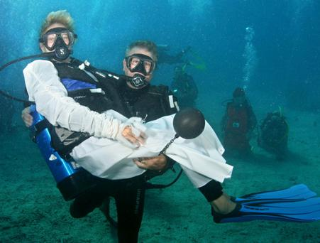 Taking the plunge: Tom Loveday cradles his bride, Lena Scott, after the couple exchanged vows underwater in the Florida Keys. 'One wedding organiser quoted recently in this newspaper's marriage series noted how couples are now much more inclined to tailor their wedding day to their individual tastes.'