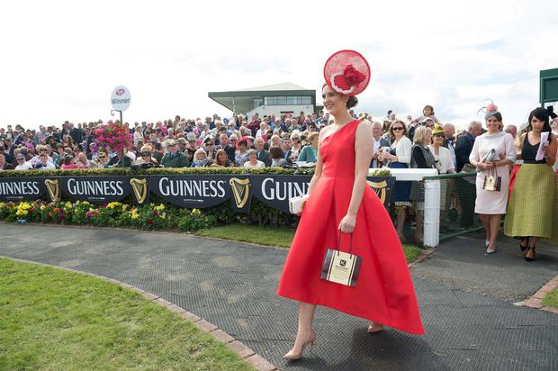 Alex Butler (in red) from Ballyedmond, Midleton, Co .Cork has scooped the coveted title of Kilkenny Best Dressed Lady at the 2015 Galway Races Ladies Day, this year sponsored by the Kilkenny Group