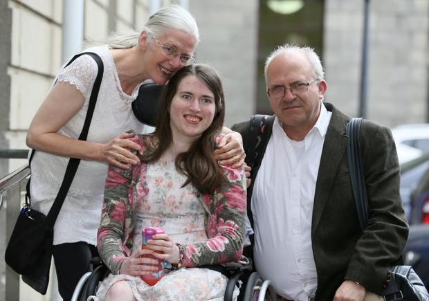 Emily Casey from Dalkey, Co. Dublin pictured leaving the Four Courts with her parents, Stephanie and Dermot after the High Court approved a €4.75million payment to her following a High Court action.