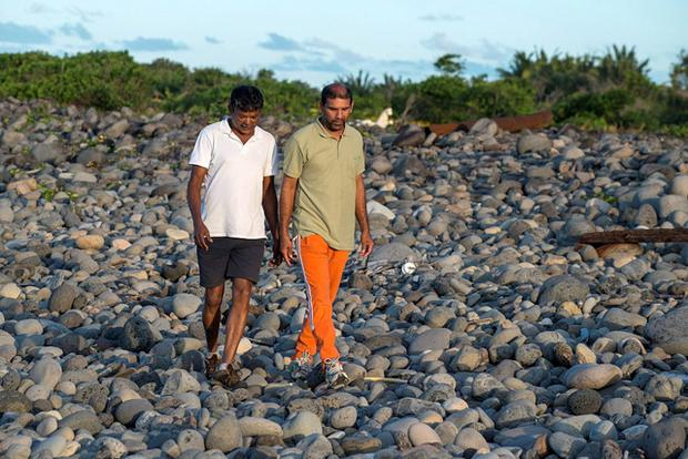 Johnny Begue (R), who found plane debris on Wednesday at the beach the French Indian Ocean island with his friend Andre Tevane Credit: Stringer