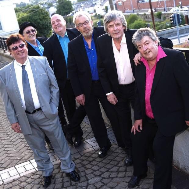 Singing stars: above, Des Lee (left) and Ray Millar (far right) with The Miami Showband as they are today