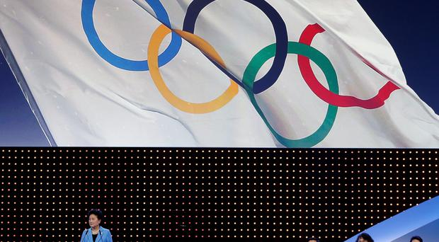 China's Vice President of State Council and Head of the Beijing 2022 delegation Liu Yandong (L) speaks during 2022 Winter Games presentation at the 128th International Olympic Committee (IOC) Session in Kuala Lumpur, Malaysia, July 31, 2015. REUTERS/OLIVIA HARRIS