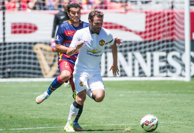 Pedro in action against Juan Mata of Manchester United